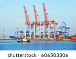 tugboat and crane in harbor... | Shutterstock . vector #606503306