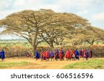 Small photo of Ngorongoro Crater, Tanzania - January 6, 2013: Masai african tribe with their colorful traditional clothing, walking away in the Ngorongoro Crater.