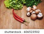 vegetables on a wooden... | Shutterstock . vector #606523502