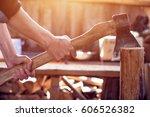 hands of a man splitting wood...   Shutterstock . vector #606526382