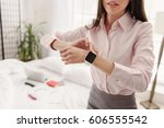 Small photo of Happy young female getting ready for work