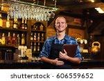 waiter giving menus | Shutterstock . vector #606559652