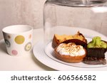 a cup of tea and cake under a...   Shutterstock . vector #606566582
