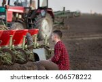 young farmer with laptop... | Shutterstock . vector #606578222