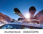 car roof with two pairs of skis ... | Shutterstock . vector #606632696