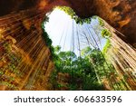 cenote with lovely opening in... | Shutterstock . vector #606633596