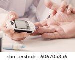 measuring blood sugar | Shutterstock . vector #606705356