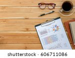 office desk table with analysis ... | Shutterstock . vector #606711086