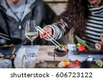 hands eat sushi with chopsticks | Shutterstock . vector #606723122
