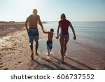 happy family hold hands and run ... | Shutterstock . vector #606737552