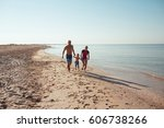 happy family hold hands and run ... | Shutterstock . vector #606738266