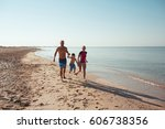 happy family hold hands and run ... | Shutterstock . vector #606738356