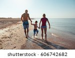 happy family hold hands and run ... | Shutterstock . vector #606742682