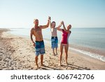 happy family hold hands and run ... | Shutterstock . vector #606742706