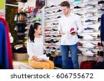 male shop assistant helping... | Shutterstock . vector #606755672