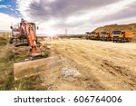 Excavator And Trucks Working O...