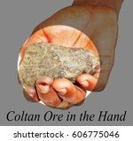 Small photo of A piece of Coltan ore in injured hand Congolese man ,ore is widely used in the most modern technology