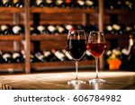 two glasses filled with wine...   Shutterstock . vector #606784982