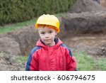 little boy with a spade helps... | Shutterstock . vector #606794675