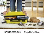 preparation travel suitcase at... | Shutterstock . vector #606802262