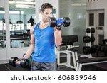 muscular man lifting dumbbells... | Shutterstock . vector #606839546