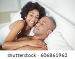 peaceful couple on the bed at... | Shutterstock . vector #606861962