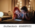 two young girls using tablet... | Shutterstock . vector #606889052