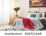 grey bed with red blanket in... | Shutterstock . vector #606921668