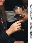 Small photo of people consider the color of the wine and try how it smells in different glasses