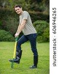 portrait of young man standing... | Shutterstock . vector #606946265