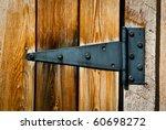 Old Rusty Hinge On Wooden Door