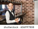 barmaid taking orders on... | Shutterstock . vector #606997808