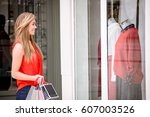 beautiful woman window shopping ... | Shutterstock . vector #607003526