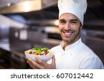 handsome chef presenting pasta... | Shutterstock . vector #607012442