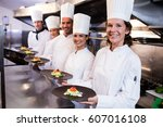 happy chefs presenting their... | Shutterstock . vector #607016108