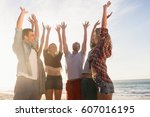 happy friends giving high five... | Shutterstock . vector #607016195