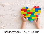 top  view  on child's hands...   Shutterstock . vector #607185485