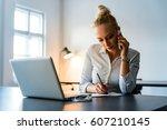 attractive businesswoman... | Shutterstock . vector #607210145