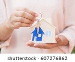 female hand holding keys with... | Shutterstock . vector #607276862