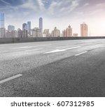roads and urban skyline | Shutterstock . vector #607312985