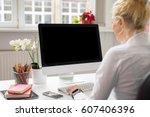 woman in office working on... | Shutterstock . vector #607406396