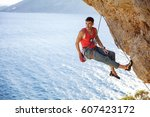 male rock climber resting while ... | Shutterstock . vector #607423172