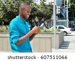 african american man surfing... | Shutterstock . vector #607511066