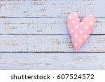 pink heart shape on pastel blue ... | Shutterstock . vector #607524572