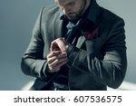 handsome stylish man adjusting...
