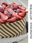 Small photo of Stripey mousse cake with berries