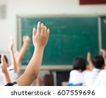 raised hands in class of middle ... | Shutterstock . vector #607559696