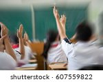 raised hands in class of middle ... | Shutterstock . vector #607559822