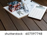 a calculator in front of a... | Shutterstock . vector #607597748