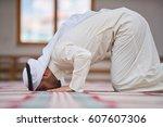 religious muslim man praying... | Shutterstock . vector #607607306